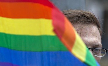 A protester is seen behind a rainbow flag at a demonstration outside Sheraton Hotel where U.S. President Obama was attending a function in New York