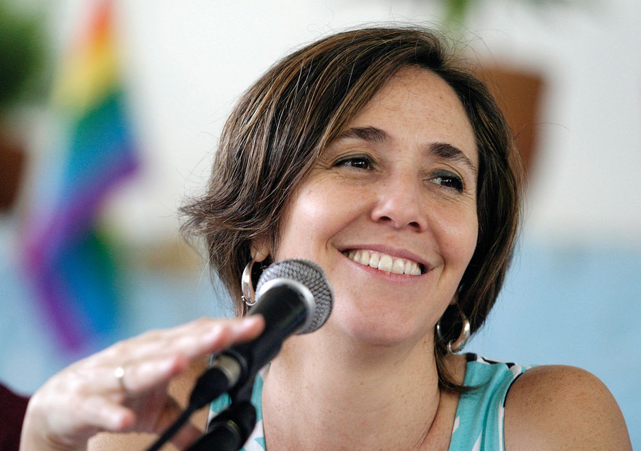 Mariela Castro, head of Cuba's National Center for Sex Education and daughter of Cuba's acting President Castro, smiles during event in Havana