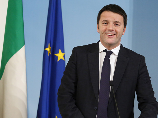 Italy's Prime Minister Renzi smiles as he arrives to lead a news conference at Chigi palace in Rome