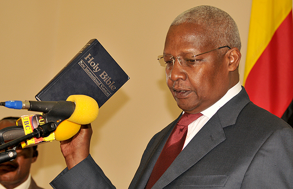 sam-kutesa-holding-bible