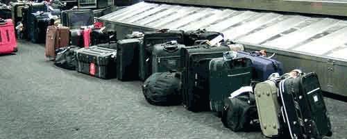 migrantes-retorno-maletas-500x220