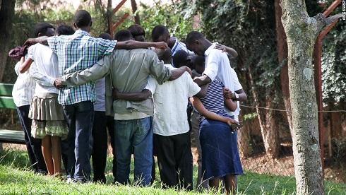 140422150126-rwanda-artificial-families-praying-horizontal-large-gallery