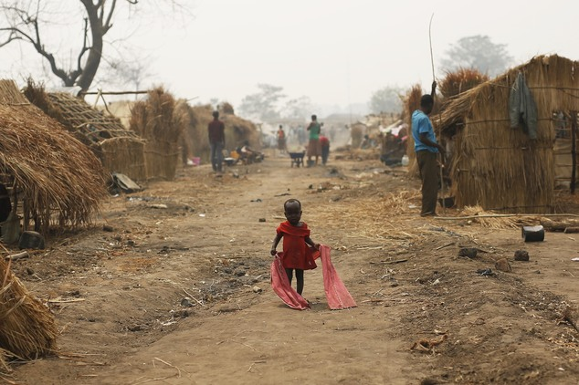 A Christian child walks through a refugee camp in Kaga-Bandoro, Central African Republic, Tuesday Feb. 16, 2016. Refugees in the north of Central African Republic say they hope the new president will bring peace but no one is heading home just yet. Thousands are still living in displacement camps in Kaga-Bandoro, a stronghold of the former Muslim rebel group known as Seleka that was in power for nearly a year. The one-time rebels say they are waiting to see how the election turns out before taking any action. (AP Photo/Jerome Delay)