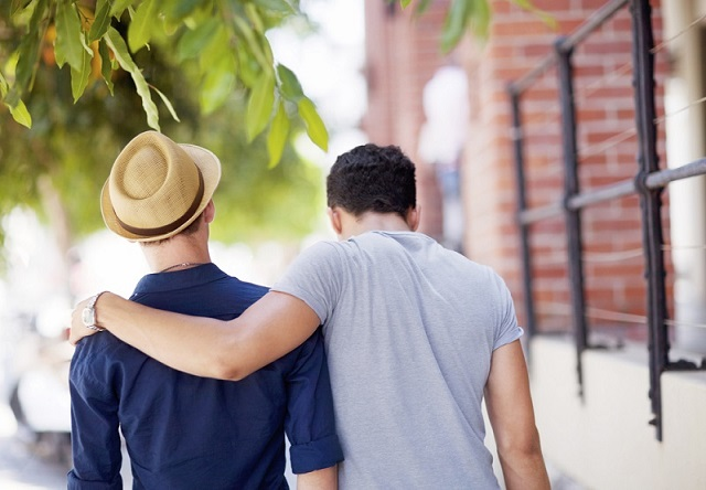 Shot of a young gay couple walking outdoors