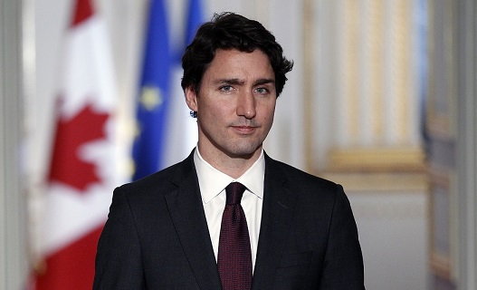 PARIS, FRANCE - NOVEMBER 29: Canadian Prime minister, Justin Trudeau makes a statement during a press conference next to French President Francois Hollande at the Elysee Presidential Palace on November 29, 2015 in Paris, France. France will host climate change conference COP21 in Paris from November 30 to December 11, 2015. (Photo by Chesnot/Getty Images)