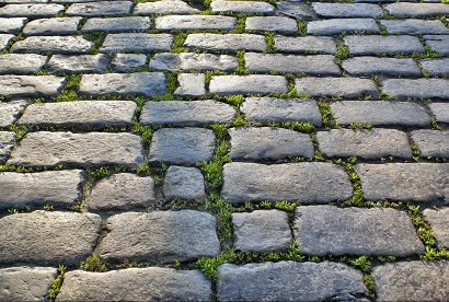 depositphotos_3827818-stock-photo-cobblestone-road-with-grass