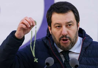 Italian Northern League leader Matteo Salvini shows a rosary as he speaks during a political rally in Milan, Italy February 24, 2018. REUTERS/Tony Gentile