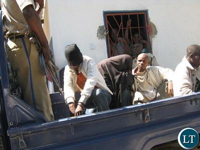 the-two-kapiri-gay-men-being-taken-away-after-making-court-appearance