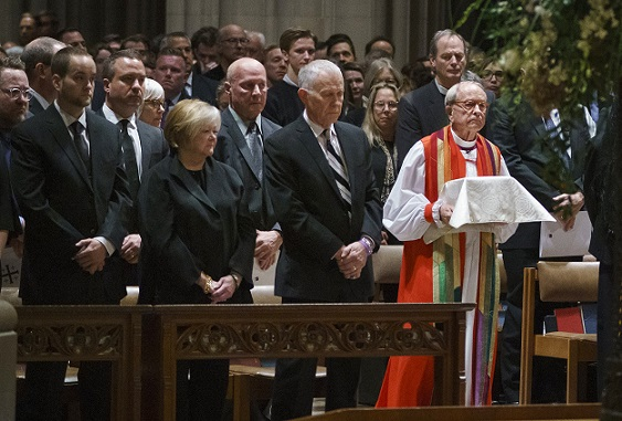 "Dennis and Judy Shepard and their son Logan Shepard, left, stand as the ashes of Matthew Shepard are brought forward by Rev. V. Gene Robinson during the procession during the ""Thanksgiving and Remembrance of Matthew Shepard"" service at Washington National Cathedral in Washington, Friday, Oct. 26, 2018. The ashes of Matthew Shepard, whose brutal murder in the 1990s became a rallying cry for the gay rights movement, will be laid to rest in Washington National Cathedral. (AP Photo/Carolyn Kaster)"