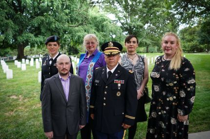 From left: Retired Army lieutenant colonel Ann Murdoch; Transgender American Veterans Association Vice President Gene Silvestri; Yvonne Cook-Riley; retired Army major and Transgender American Veterans Association President Evan Young; petty officer first class Alice Ashton; and retired Air Force major Nella Ludlow pose for a photo in Arlington National Cemetery after attending a wreath laying ceremony at the Tomb of the Unknown Soldier on June 8, 2018. - President Donald Trump has made clear his opposition to transgender Americans serving in the military, but that didn't deter several transgender veterans from laying a wreath Friday, June 8, 2018 at the Tomb of the Unknown Soldier just outside Washington. (Photo by Mandel Ngan / AFP) / With AFP Story by Elodie CUZIN & Michael MATHES: US-military-transgender-politics (Photo credit should read MANDEL NGAN/AFP/Getty Images)