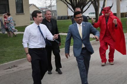 DES MOINES, IOWA - APRIL 17: Democratic presidential candidate and South Bend, Indiana Mayor Pete Buttigieg (L) leaves a campaign event hosted by the Asian Latino Coalition at the Machinists Hall as a protester follows on April 17, 2019 in Des Moines, Iowa. Buttigieg is on his first visit to the state since announcing that he was officially seeking the Democratic nomination during a rally in South Bend on April 14. (Photo by Scott Olson/Getty Images)