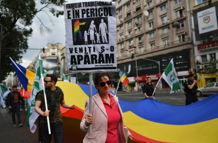 "A woman holds a pancarte reading in Romanian ""The traditional family is in danger, come toghether to defend it!"" during a protest againnst homosexuality in Bucharest May 20, 2017. Dozens of people, supporters of far-right party Noua Dreapta (The New Right) marched downtown Bucharest prior to incoming ""Bucharest Pride"" to express their support for the traditional family and to protest against homosexuality shouting ""Romania doesn't tolerate the homosexuals"" and ""Romania, an (Christian) Orthodox country"". / AFP PHOTO / DANIEL MIHAILESCU (Photo credit should read DANIEL MIHAILESCU/AFP/Getty Images)"