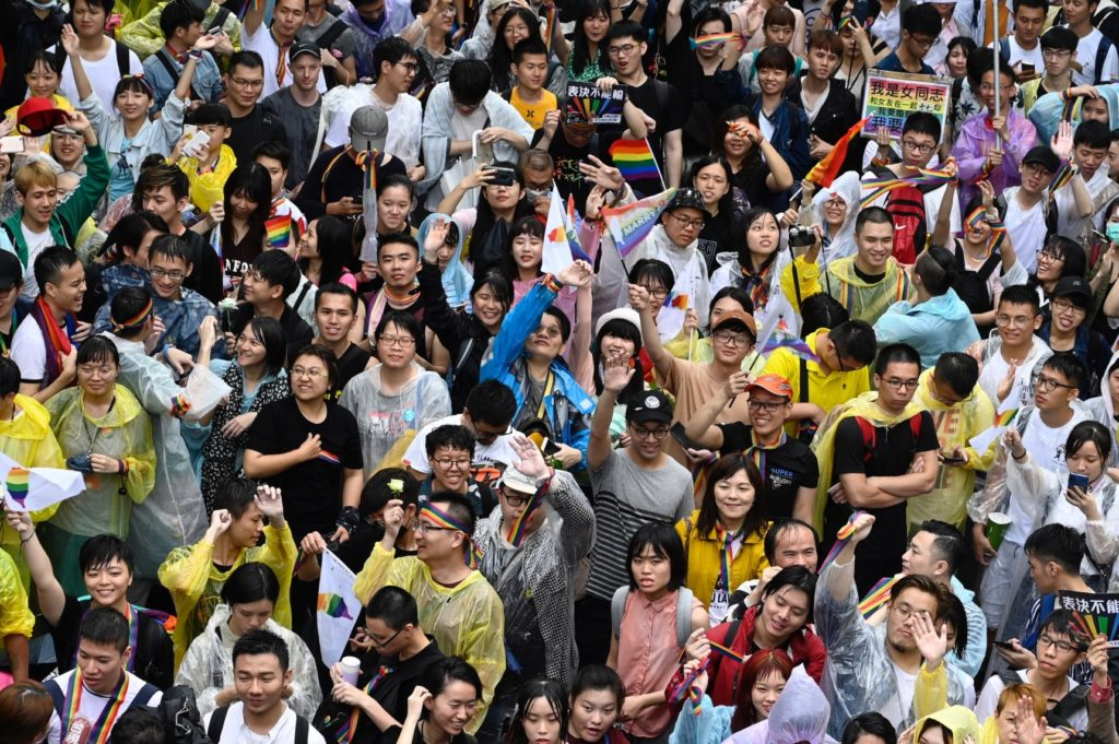 "Gay rights supporters celebrate outside Parliament after lawmakers legalised same-sex marriage bill in Taipei on May 17, 2019. - Taiwan's parliament began debating Asia's first gay marriage law as conservative lawmakers launch a last-ditch attempt to scupper the most progressive bill in favour of a watered-down ""civil-union"" law. (Photo by Sam YEH / AFP) (Photo credit should read SAM YEH/AFP/Getty Images)"