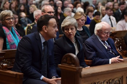 "BELFAST, NORTHERN IRELAND - APRIL 24: (L-R) Taoiseach Leo Varadkar, British Prime Minister Theresa May and President of Ireland, Michael D. Higgins sit together while Secretary of State for Northern Ireland Karen Bradley is seated behind as they attend the funeral service of journalist Lyra McKee at St Anne's Cathedral on April 24, 2019 in Belfast, Northern Ireland. Journalist and campaigner for LGBT rights, Lyra McKee, 29, was shot dead last Thursday while observing the rioting in Londonderry. Her family gave a statement in which they said her ""openness and her desire to bring people together made her totally apolitical"". The New IRA have admitted responsibility for her killing. (Photo by Charles McQuillan/Getty Images)"
