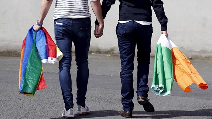 A couple walks hand in hand from the count centre in Dublin as Ireland holds a referendum on gay marriage May 23, 2015. Ireland appears to have voted heavily in favour of allowing same-sex marriage in a historic referendum that marks a dramatic social shift in the traditionally Catholic country, government ministers and opponents of the bill said on Saturday. REUTERS/Cathal McNaughton TPX IMAGES OF THE DAY