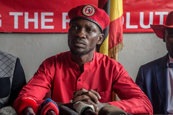 "KAMPALA, UGANDA - 2019/10/01: Musician and opposition candidate Robert Kyagulanyi aka Bobi Wine during the press conference encouraging his ""people power"" supporters to continue wearing their trademark red berets in Kampala.Uganda's military announced that red berets had been banned, and civilians in possession of them could be punished with up to five years in prison. (Photo by Sally Hayden/SOPA Images/LightRocket via Getty Images)"