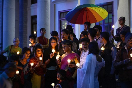 "Transgender activists and their supporters take part in a candle light vigil held as part of ""Transgender Day of Remembrance"" in Bangalore on November 20, 2015. The Transgender Day of Remembrance is marked worldwide to remember members of the transgender community who have been murdered, and to raise awareness of the threat of violence and persistence of prejudice felt by the transgender community. AFP PHOTO/Manjunath KIRAN (Photo credit should read MANJUNATH KIRAN/AFP via Getty Images)"