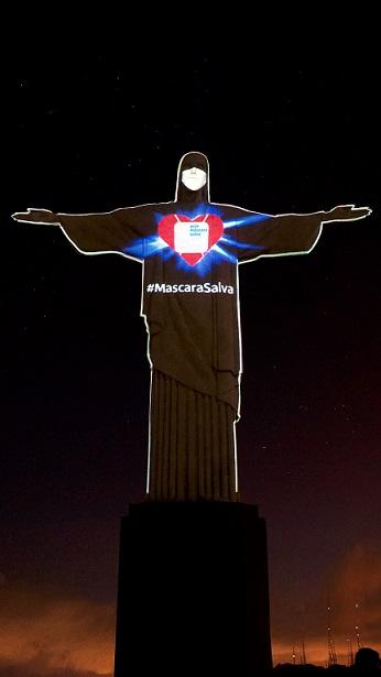 """""""Cristo Redentor obtiene mascarilla para alentar al mundo protegerse contra el Covid-19"""" – Manu Silva (PRNewsfoto/Todos pela Saúde)"""