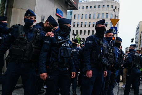 WARSAW, POLAND - MAY 23: Police officers wear protective face masks as they take security measures during a protest against the Coronavirus economic package in Warsaw, Poland on May 23, 2020. The Entrepreneurs strike, led by a presidential candidate for the upcoming 2020 elections, Pawel Tanajno started on May 7 with rallies in Warsaw, where dozens were arrested when protesting against the lack of financial support from the ruling government during the COVID-19 pandemic. (Photo by Omar Marques/Anadolu Agency via Getty Images)