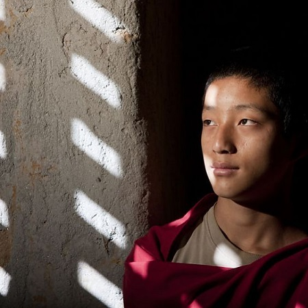 A young monk at the blue palace in Bhutan